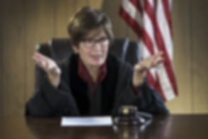 Portrait of female judge addressing the courtroom