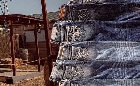 Rock Revival Jeans in Front of Bank