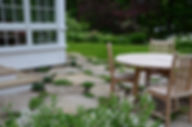 Ipswich MA fieldstone patio with plantings