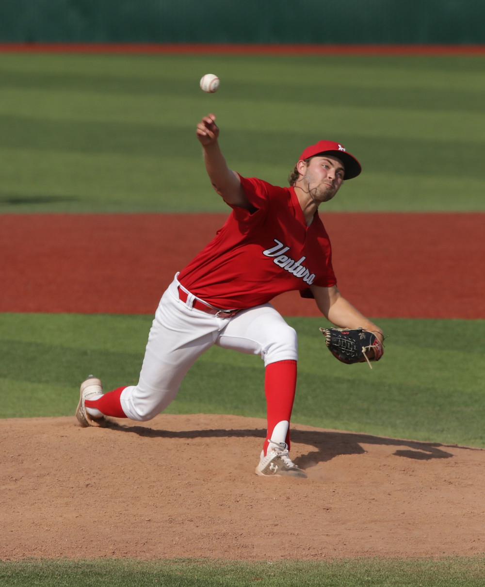 Cole Dale throws a pitch