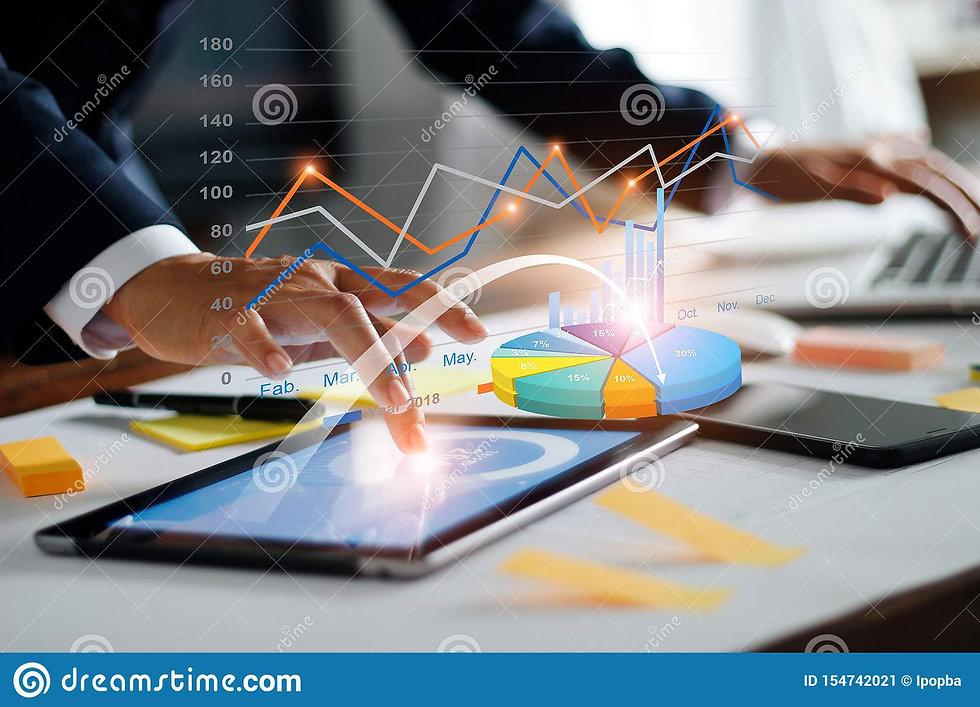 businessman-using-tablet-laptop-analyzin