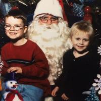 Cory and Curtis as small children sit on Santa's lap