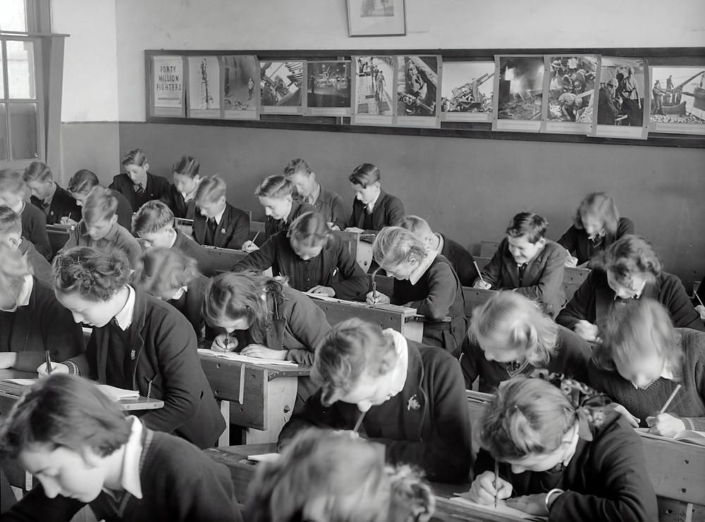 A primary school classroom of children working at their desks