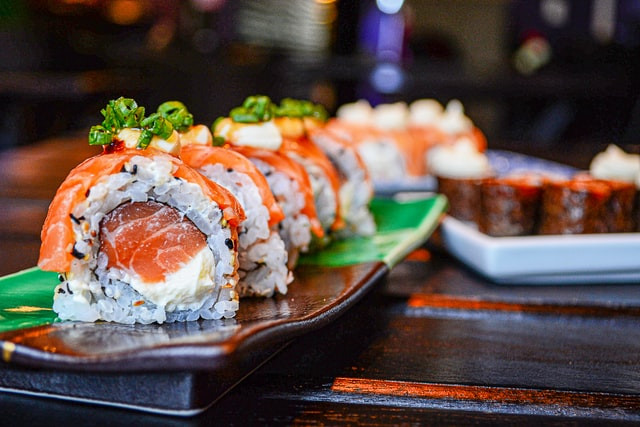 A sushi roll sits on a tray