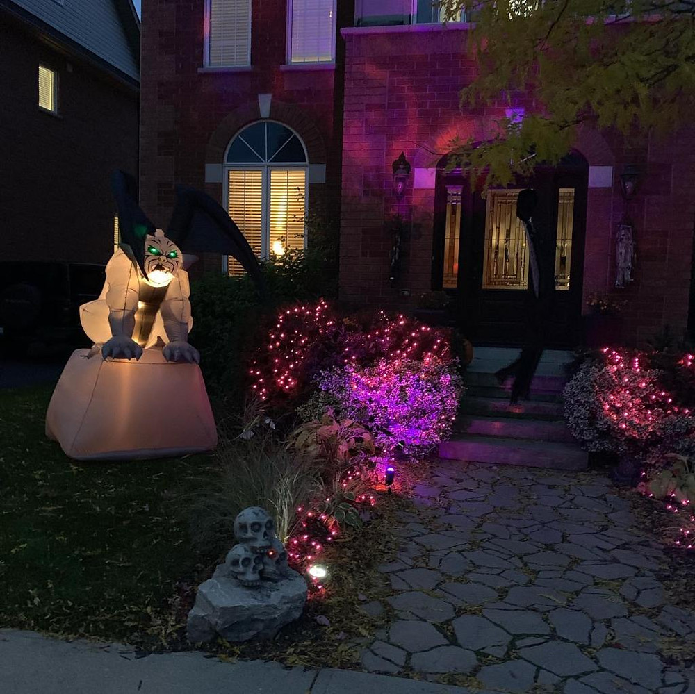 Halloween decorations and lights outside a home