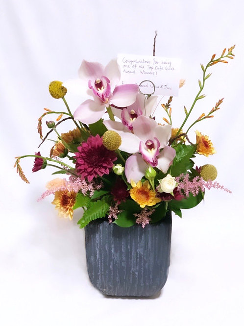 Lilac Cymbidium Orchid in Grey Cement Vase