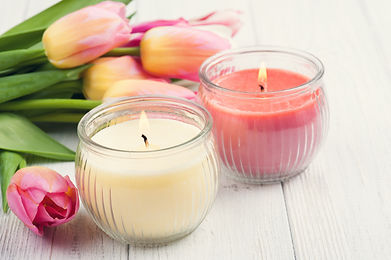 Yellow and pink aroma candles with tulip