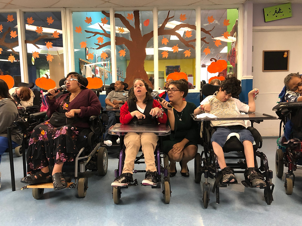 ADT participants at Ann Storck Center perform for family and friends during the Fall Harvest Festival