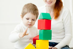 baby-playing-with-colorful-toy-blocks_11