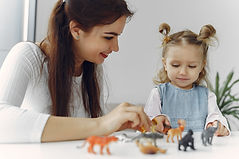 tutor-with-litthe-girl-studying-home.jpg