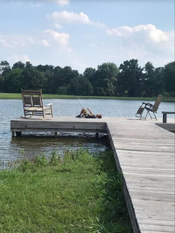 Kids Fishing On A Pier | Airbnb | The Williams Ranch | Huntsville, TX
