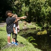 Children enjoying the bamboo pond