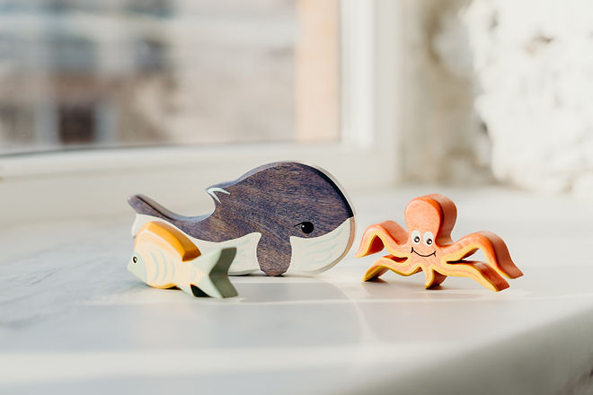 shallow-focus-photo-of-wooden-toys-36630
