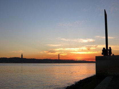 Sunset over bridge and Jesus Christ statue
