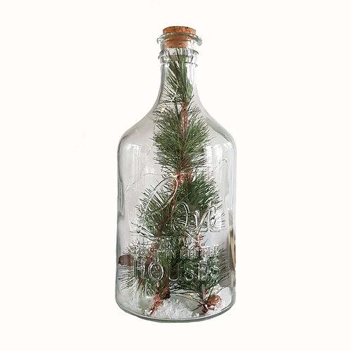 Fles met kerstversiering en ledverlichting