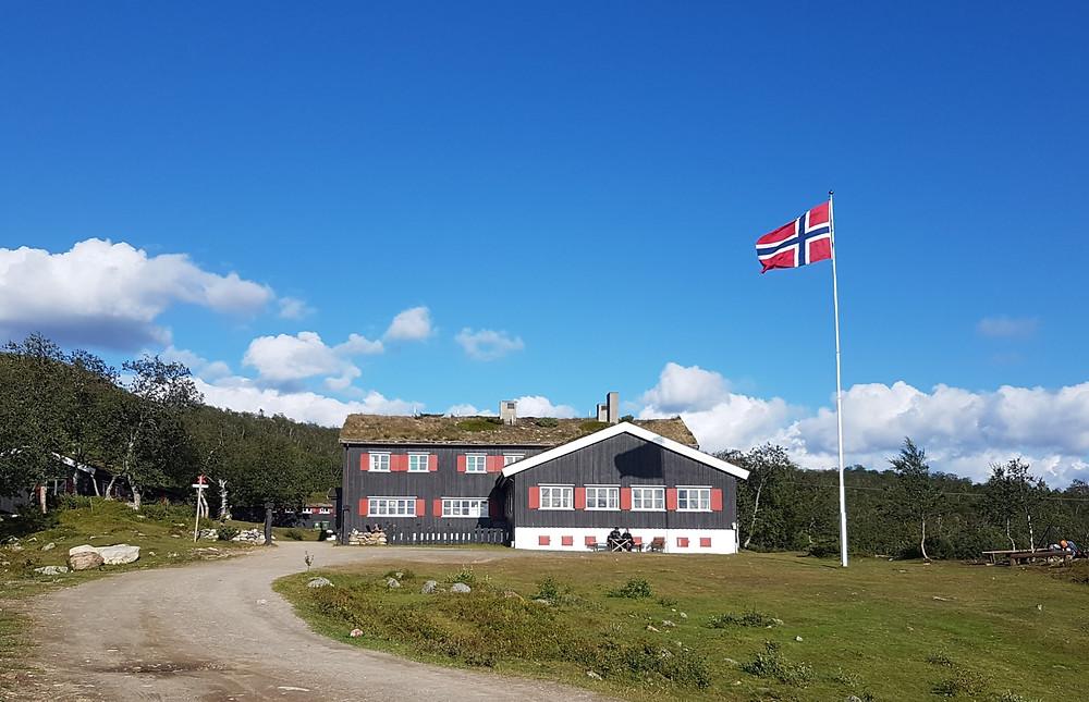 Norwegian DNT hut with Norwegian flag flying