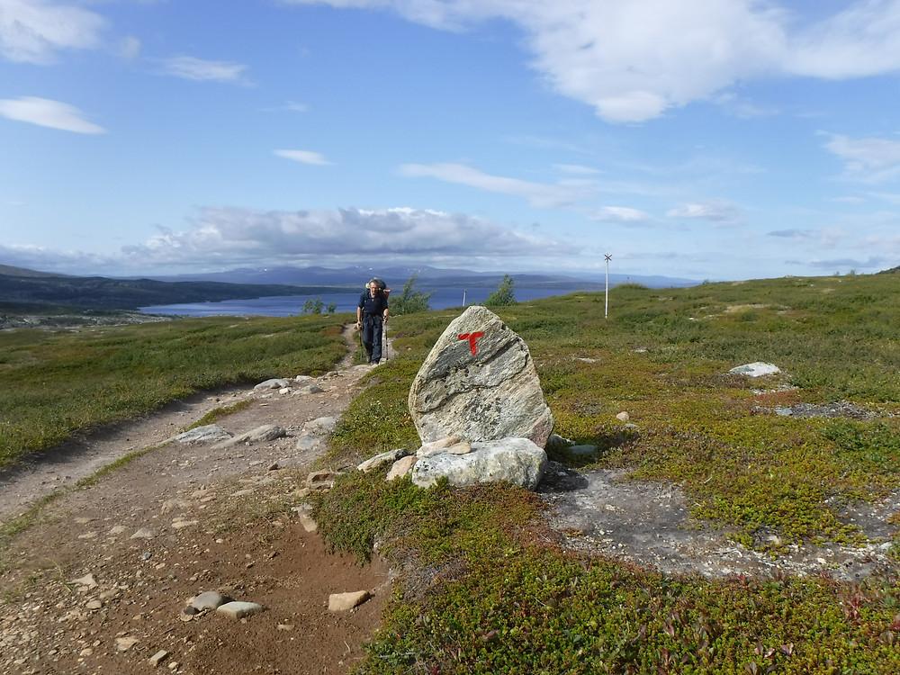 man hiking up mountain path