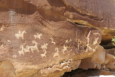Petroglyphs showing people riding horses, in Arches National Park
