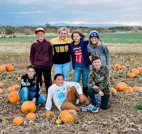 Teens at pumpkin patch Uintah Basin