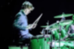 Graham Twist of John Lennon Tribute UK bashing those drums