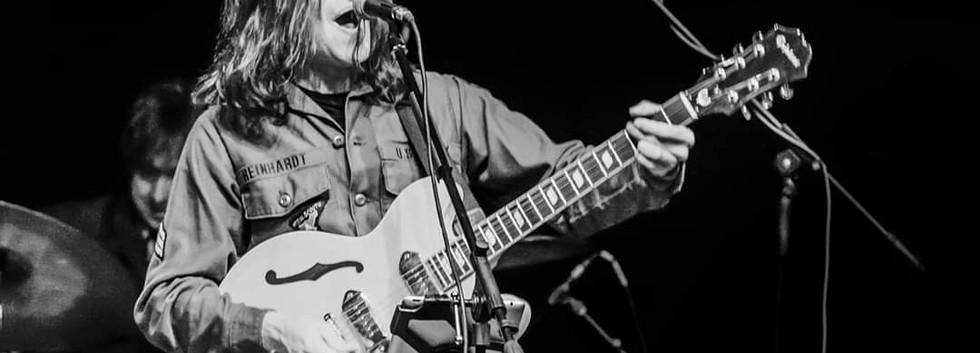 Lennon Tribute UK - guitar in hand