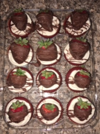 Red Velvet Cupcakes with buttercream icing topped with choc cov strawberries