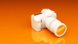 videoblocks-video-camera-on-an-orange-ba