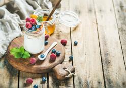 glass-jar-of-yogurt-with-berries-mint-an