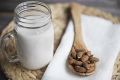 jug-of-almond-milk-and-almonds-PNUGFKR-m