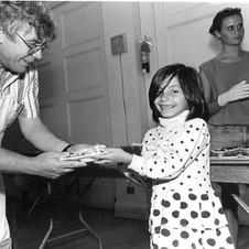 man serving little girl.jpg