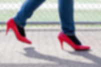 Picture of a man walkng in red high heels