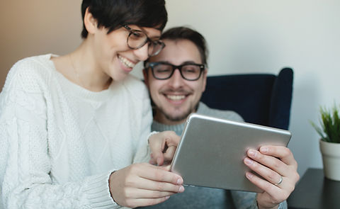 Young hipster couple in eyewear enjoying