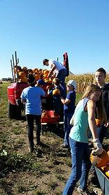 Students planting Pumpkins