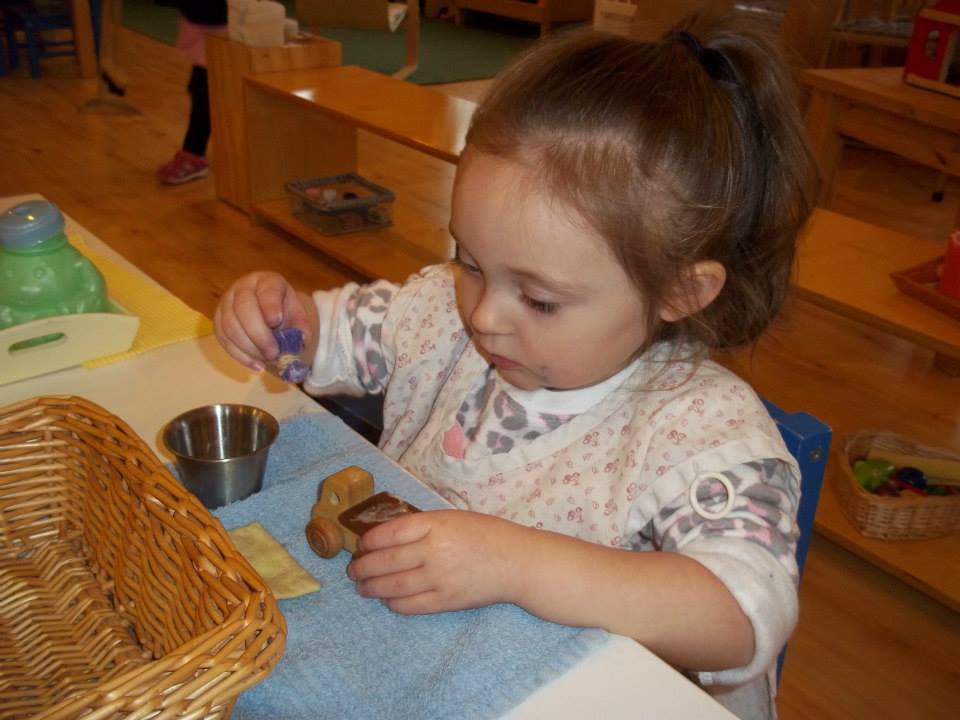 Toddler Polishing in Montessori