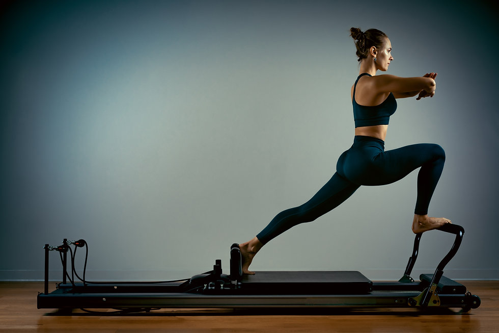 Young girl doing pilates exercises with