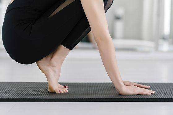 Unrecognisable sportswoman doing exercis
