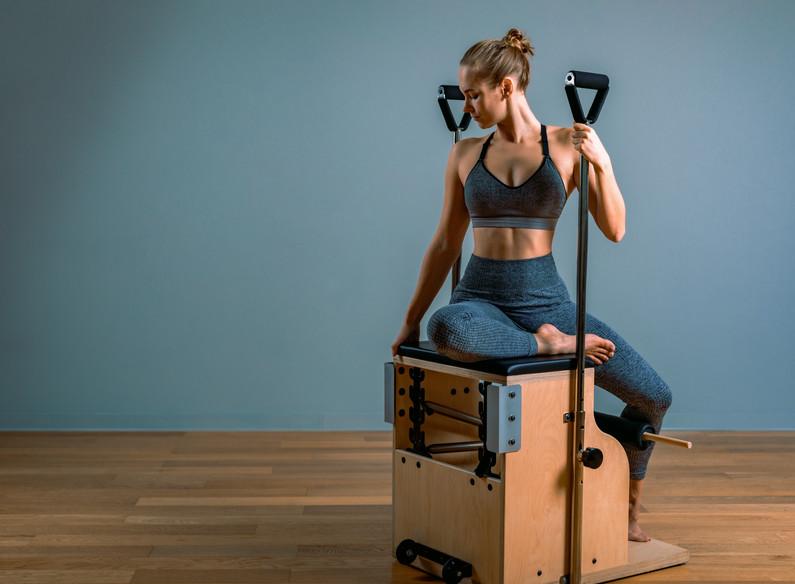 Pilates woman in a Cadillac reformer doi
