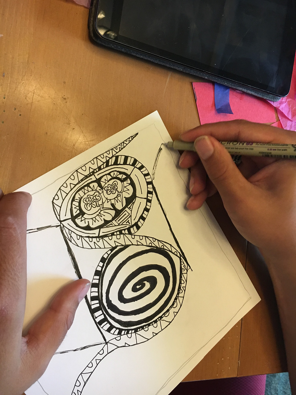 My son working on his zentangle.
