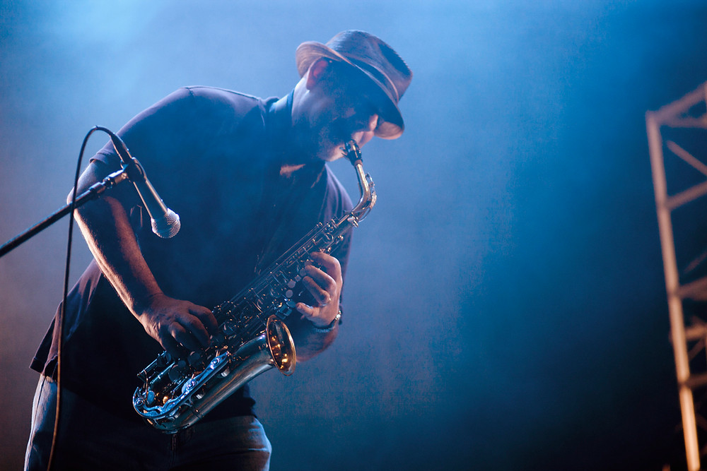 man playing sax with microphone event in Barcelona