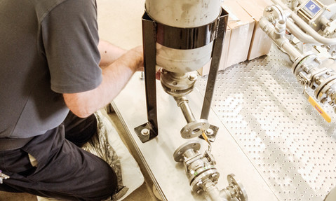 Assembling the 100 GPM platform output section.jpg
