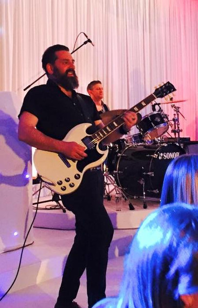 Nick Robinson Guitarust gIbson SG White Live.jpg