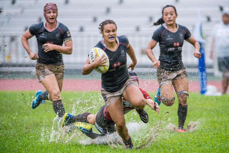 HK ctr Natasha Olson-Thorne storms away for a try v Japan