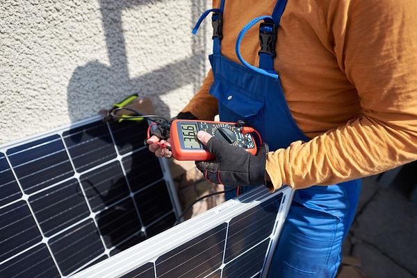 bigstock-Man-Engineer-Installing-Solar--