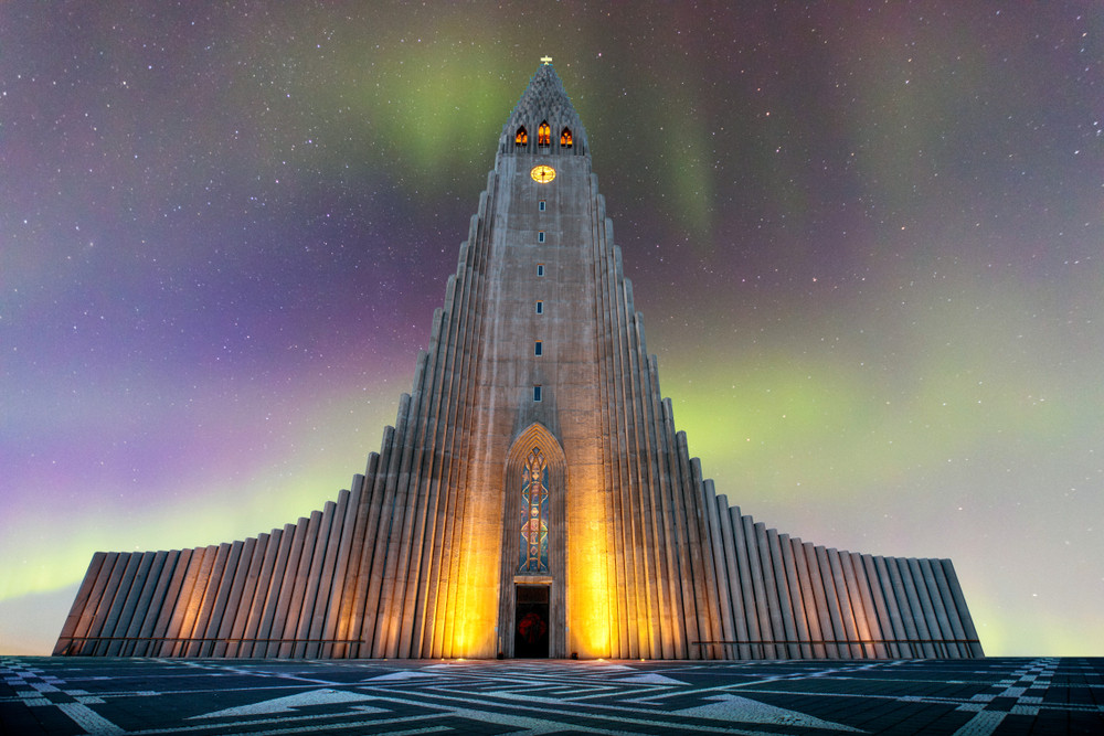 Monumental and unique church. One of the most famous churches in Iceland. Night sky with hint of Northern Lights above.