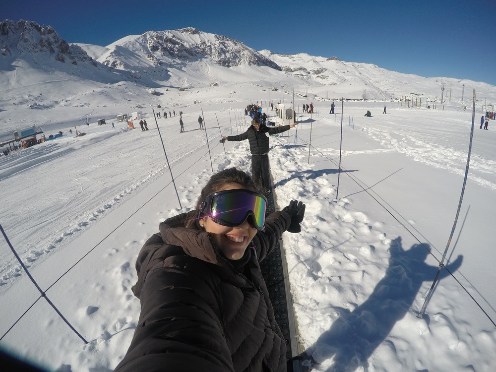 Sunny shot of your people on magic carpet in snow. Skiing in Iceland.