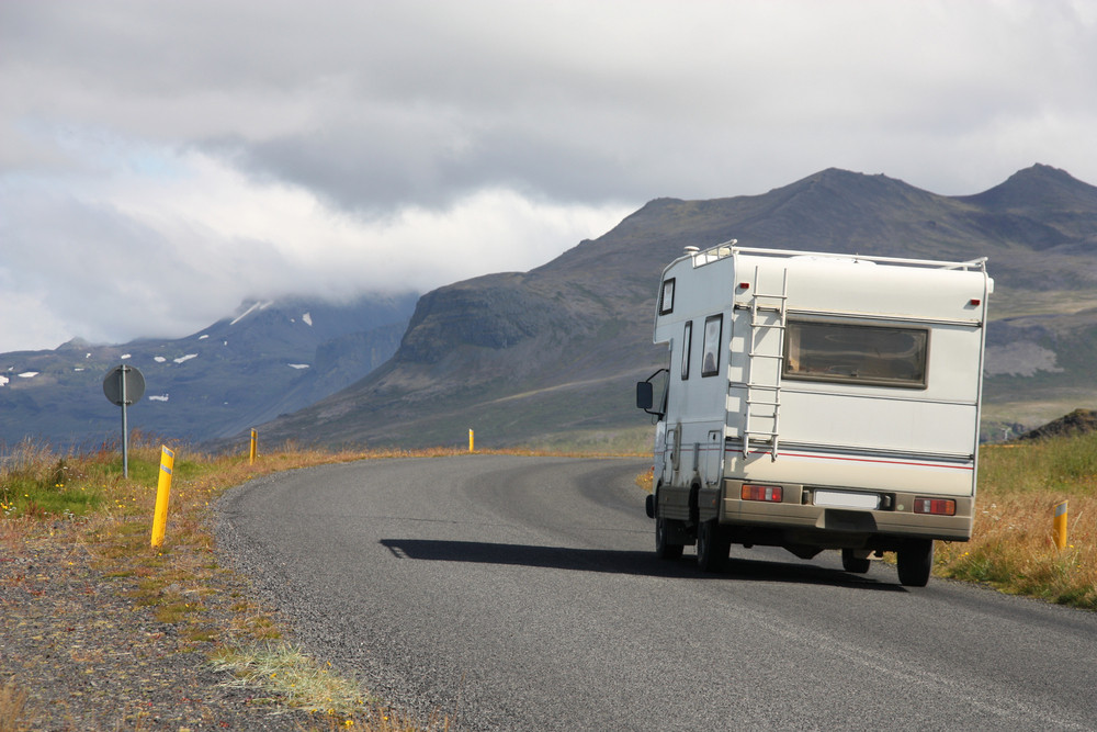 Motorhome heading off down a road. Campsites in Iceland.