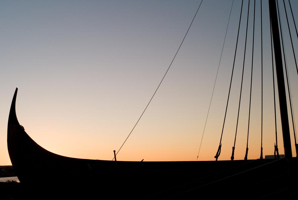 Islendingur Viking Ship silhouette and sunset.