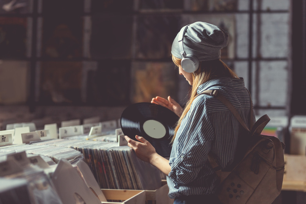 Girl looking for some Icelandic music - Best Iceland Souvenirs