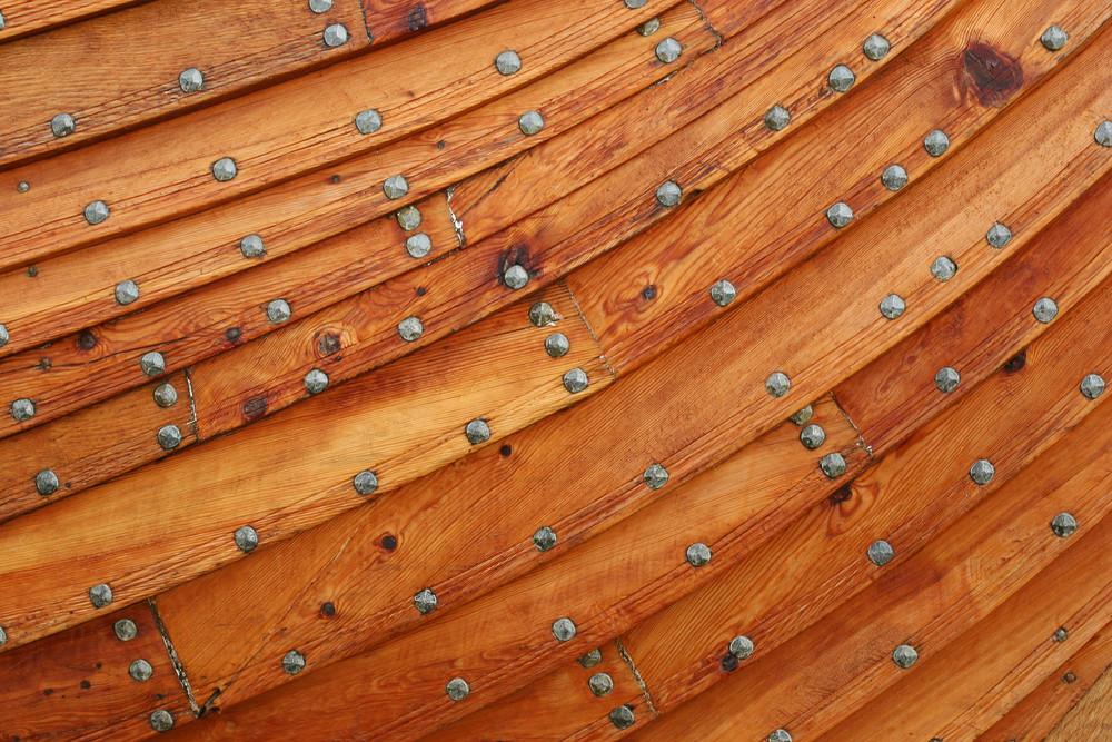 Metal rivets on overlapped planks of wood - Islendingur Viking Ship body