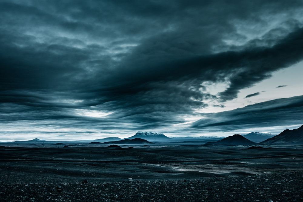 Moody sky and dark volcanic mountain scene. Iceland weather and climate can  be stormy.